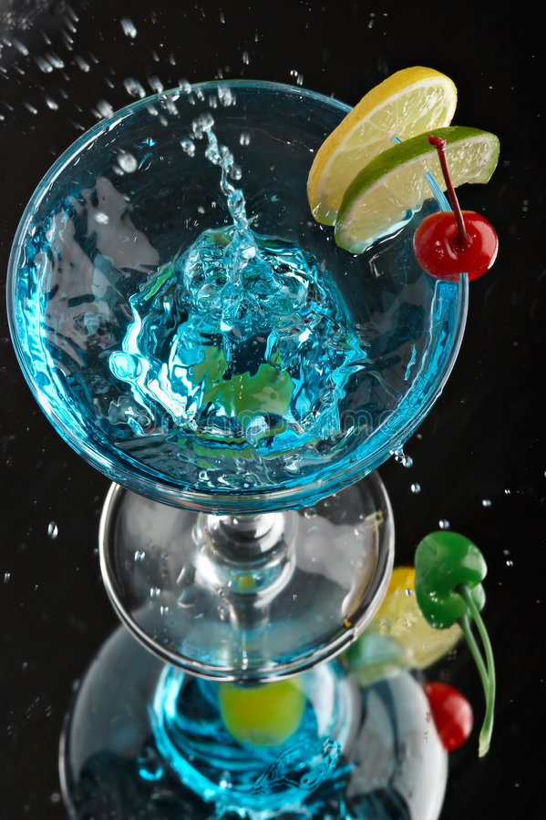 Still life with glass. With drink on the black background royalty free stock photography