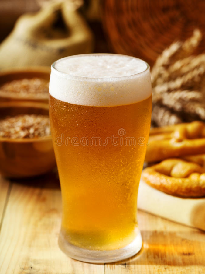 Still life with glass of beer. On wooden table stock photos