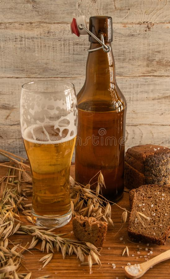 Still life from a glass and bottles with beer stock images
