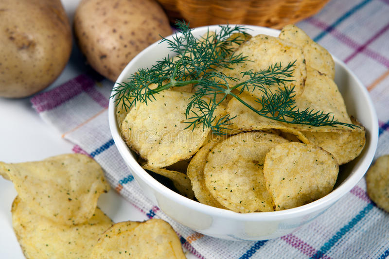 Still life from a glass bowl with potato chips stock photos