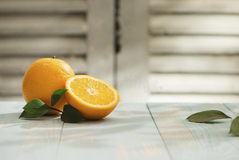 Still Life Glass of Fresh Orange Juice on Vintage Wood Table with Copy Space Background.  stock photo