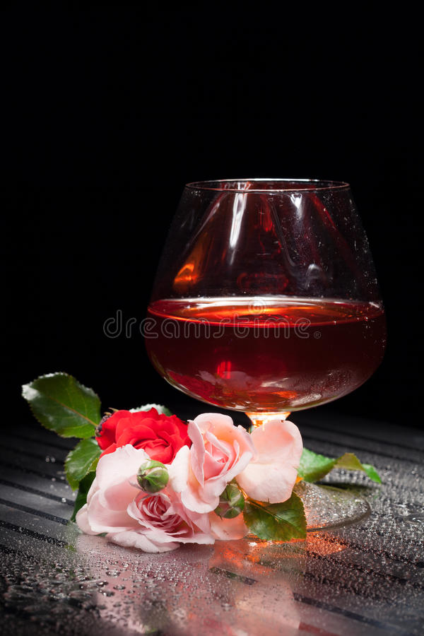 Still Life With Glass And Rose. Still life with glass of wine and pink roses royalty free stock image