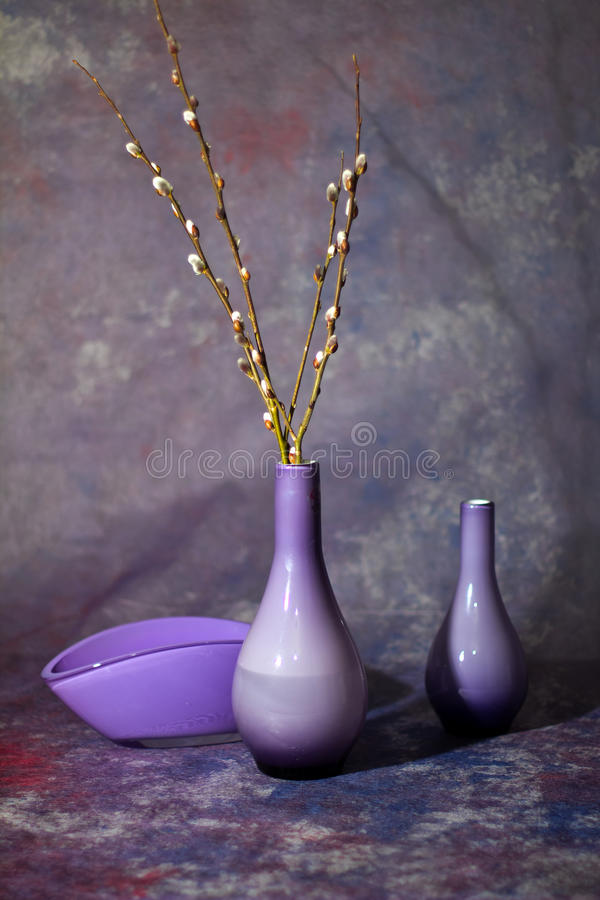 Still life with glass vases. And twigs of willow royalty free stock image