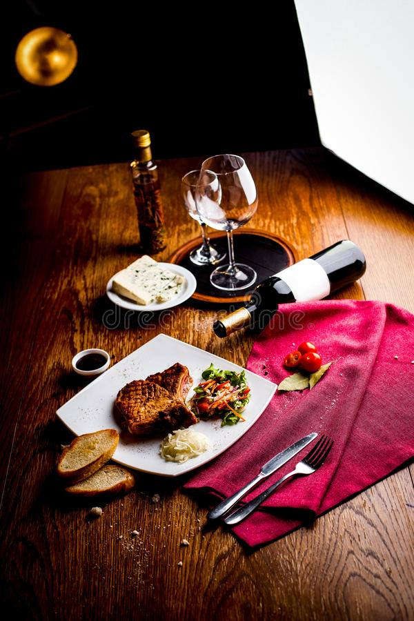 Still life gourmet dinner grilled beef fillet on wooden table royalty free stock photo