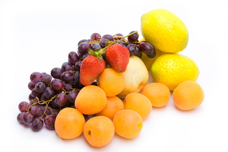 Still life of grape, lemons, pears, strawberry royalty free stock photos