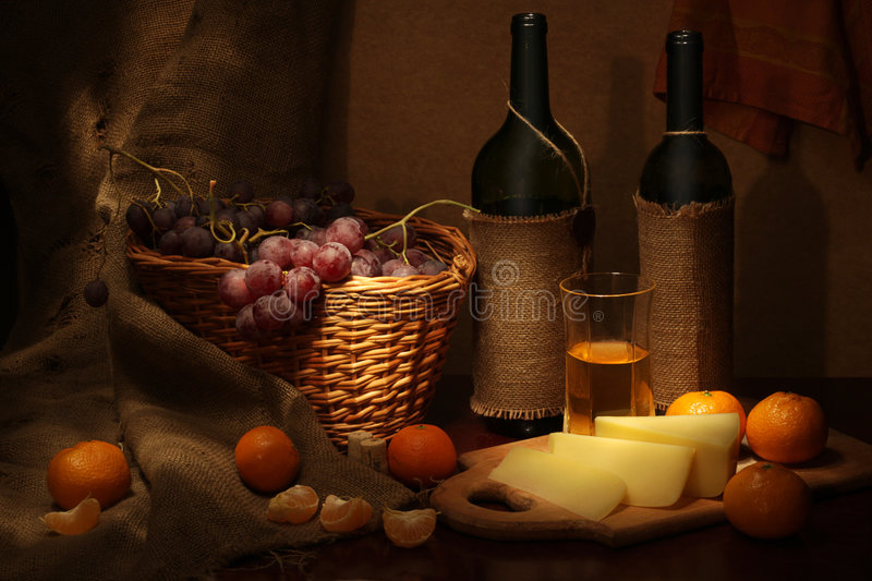 Still life with grape and tangerines stock photography