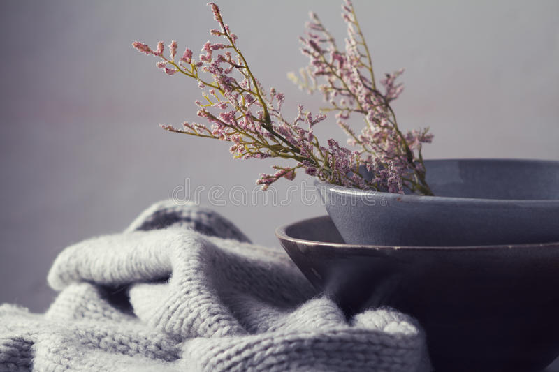 Still life gray vintage bowls with flowers horizontal royalty free stock photo