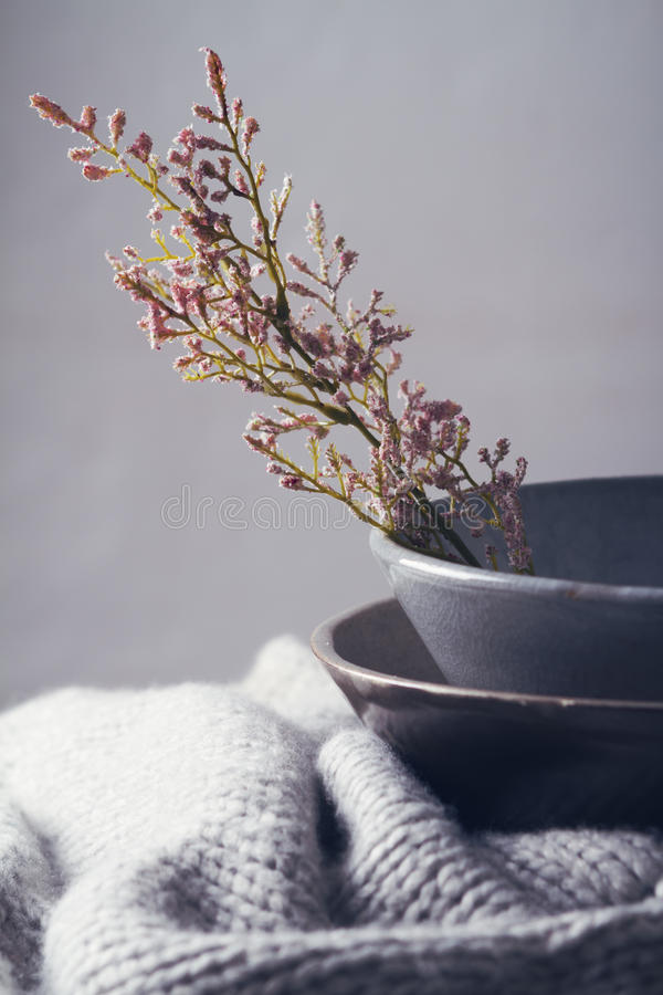 Still life gray vintage bowls with flowers stock photos