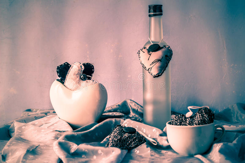 Still life with handmade hearts cups bottle stock photography