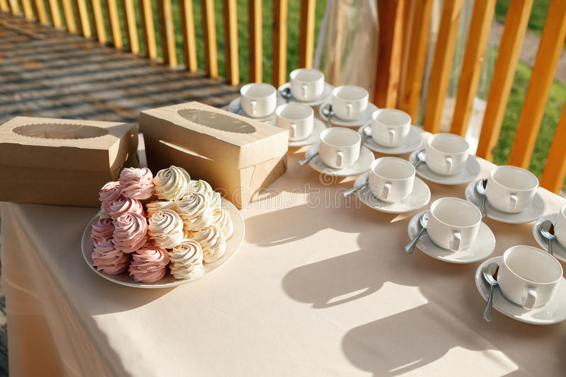 Still life with homemade marshmallows, meringues and tea set many cups stock images