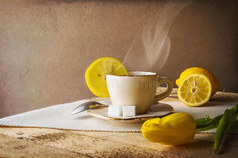 Still life hot cup of tea lemons royalty free stock images