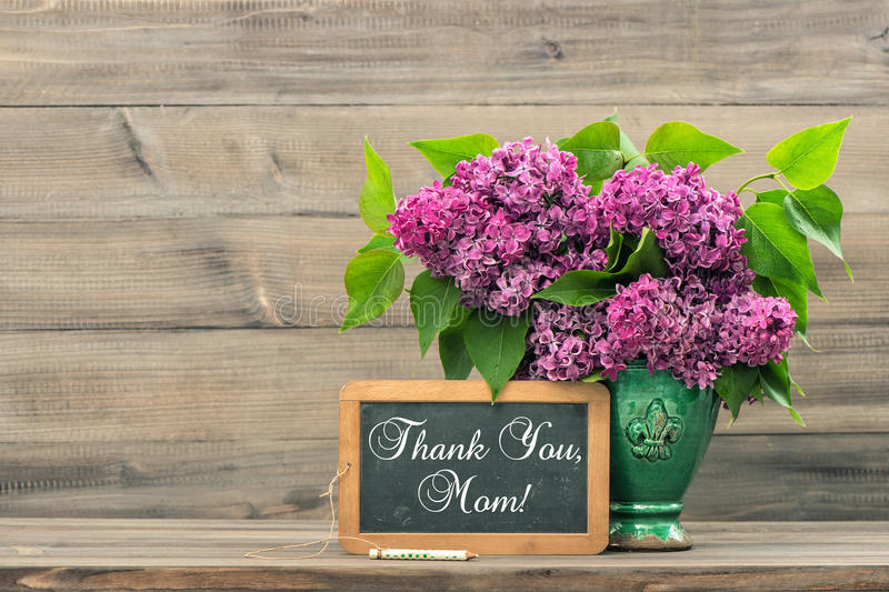 Still life with ilac flowers in a vase. Thank You Mom stock photography