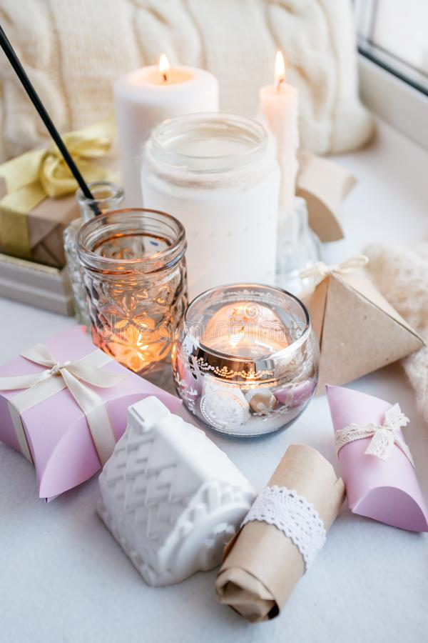 Still life with interior details and burning candles in the living room, the concept of home comfort and interior, romantic gift stock photography