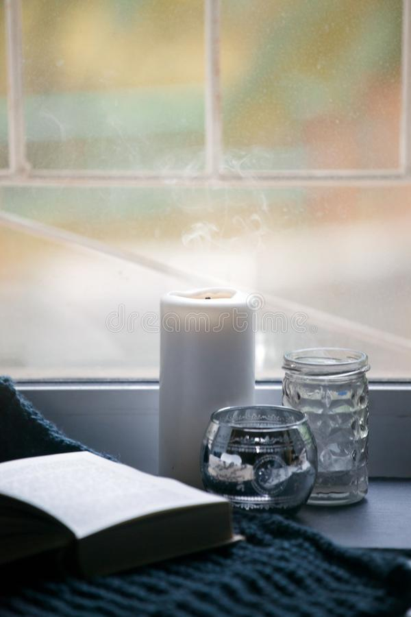 Still life with interior details and burning candles in the living room, the concept of home comfort and interior, unplag, relax. Mindfulness background royalty free stock image