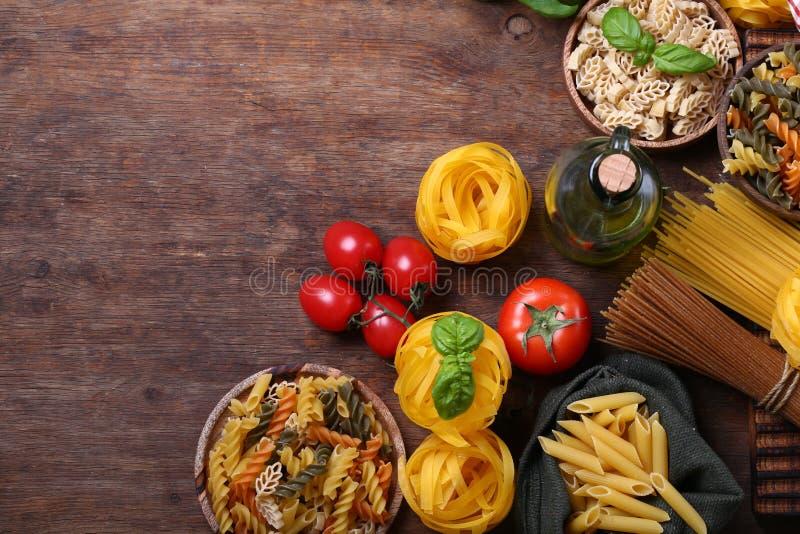 Still life italian food. Pasta tomatoes garlic basil and olive oil stock image