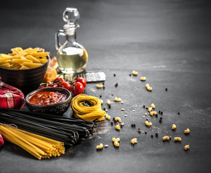Still life of Italian pasta on grey stone background royalty free stock photos