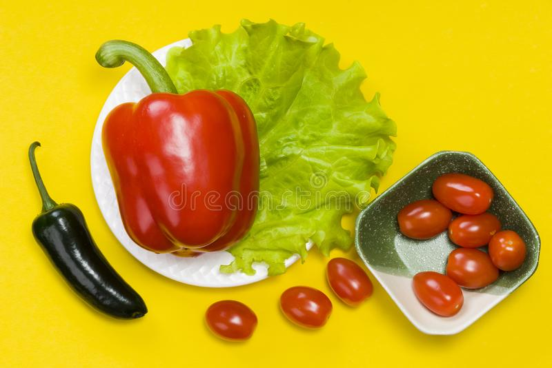 Still life of jalapeno pepper,  bell pepper, tomato cherry, lettuce royalty free stock image