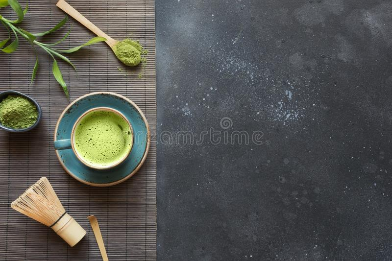 Still life with Japanese matcha green tea on black table. Top view. Space for text stock image