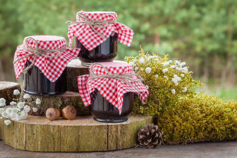 Still life with jars of jam and decoration in rustic style. Still life with three jars of jam and decoration in rustic style royalty free stock photography