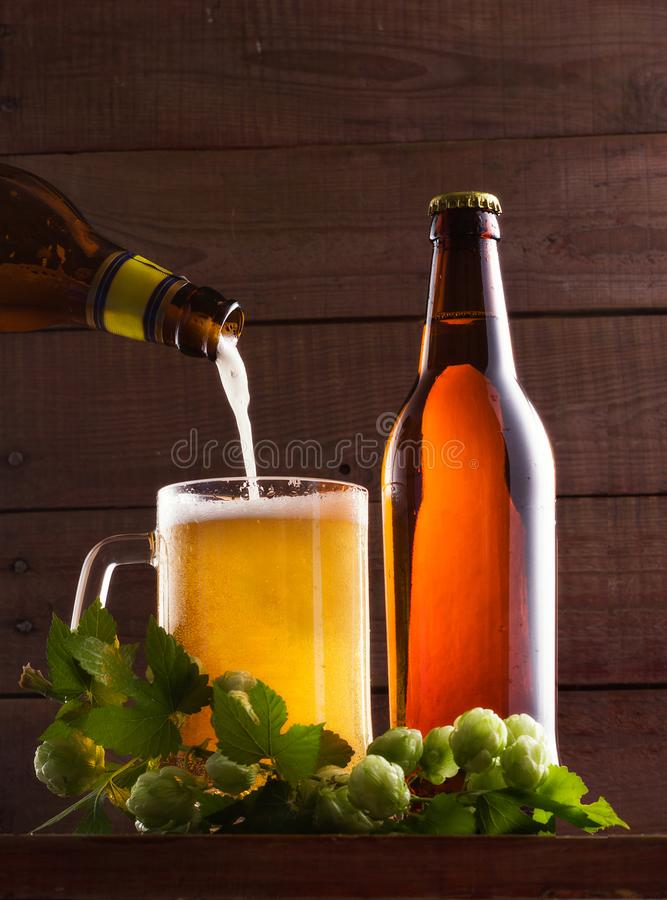 Still life with a keg of beer and hops. royalty free stock photography