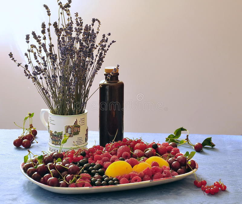 Still life with lavender variety of berries and fruits royalty free stock image