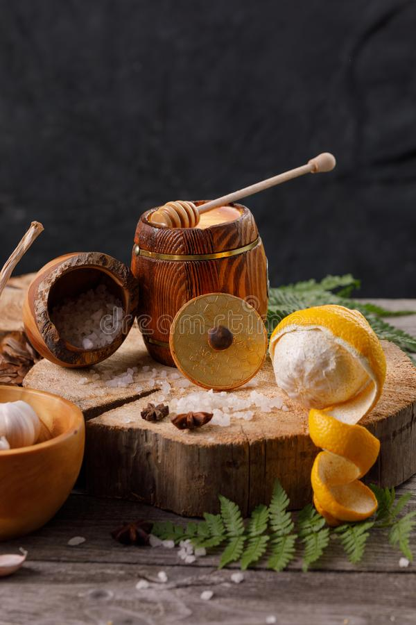 Still life with lemon and honey, on a wooden background in a rustic style. The concept of treating colds. Ethnoscience. Close-up stock image