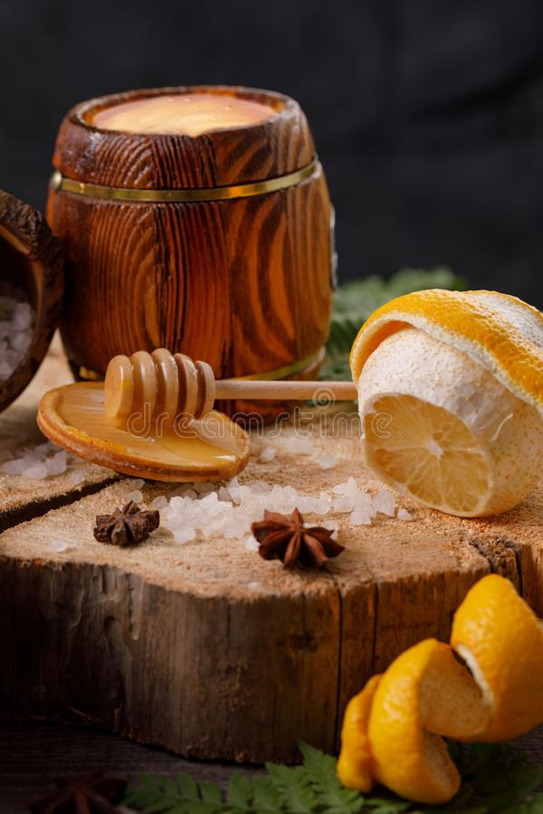 Still life with lemon and honey, on a wooden background in a rustic style. The concept of treating colds. Ethnoscience. Close-up stock photography