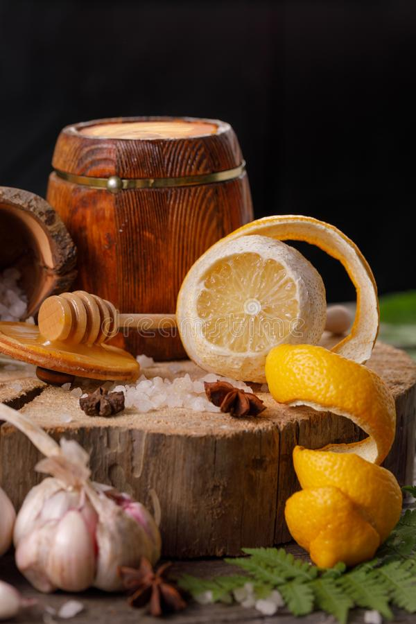 Still life with lemon and honey, on a wooden background in a rustic style. The concept of treating colds. Ethnoscience. Close-up royalty free stock photos