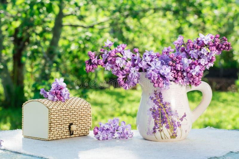 Still life with a lilac box on a napkin royalty free stock photos