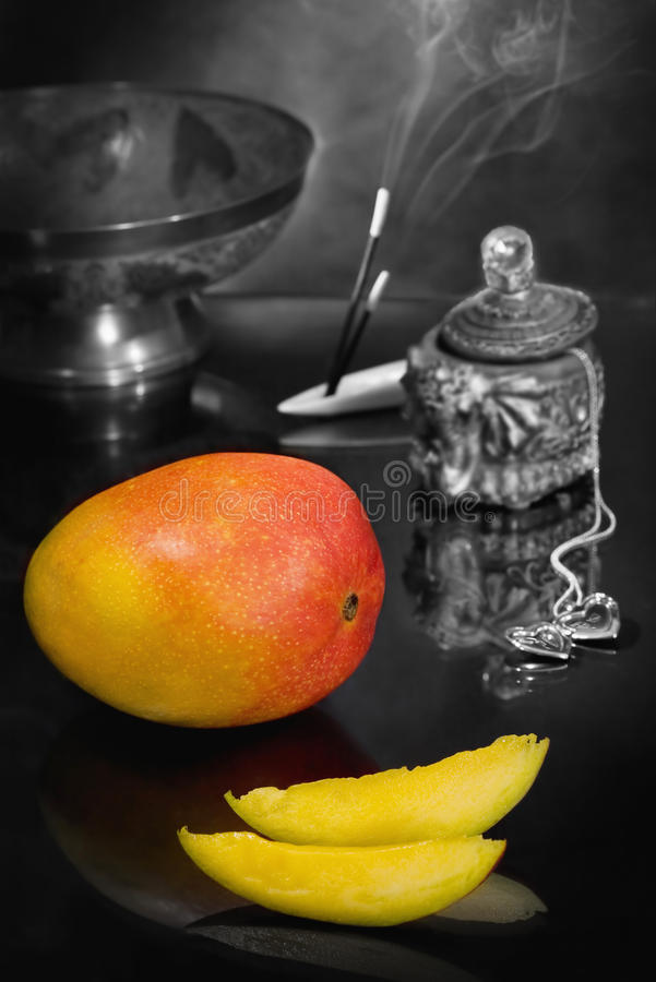 Still life with mango Flavor of the East stock photography