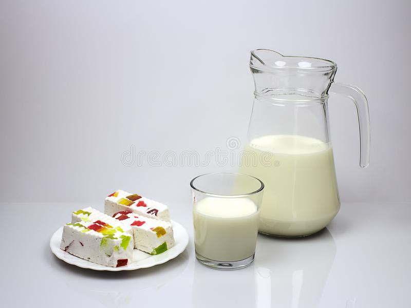 Still life with milk and marshmallow for breakfast. royalty free stock photography