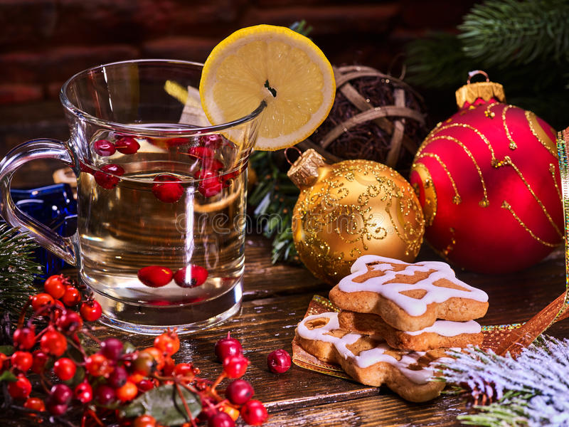 Still life with mug mulled wine and Christmas ball . Christmas still life with mug mulled wine. Warming mulled wine with cookie in form of house and Christmas stock photo