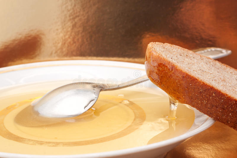 The still life with the natural honey and slice of bread stock photos