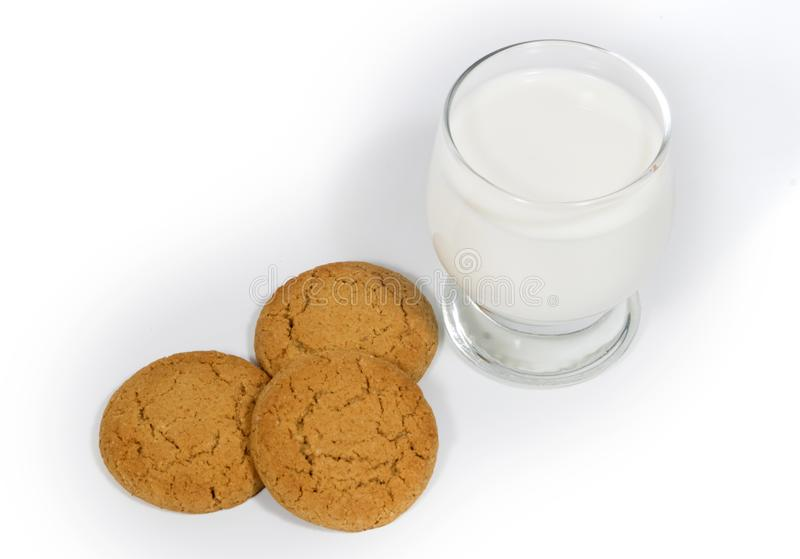 Still-life with oatmeal cookies and a glass of milk. Oatmeal cookies on a white background and a glass of milk. Confectionery still life. Pastry stock photo