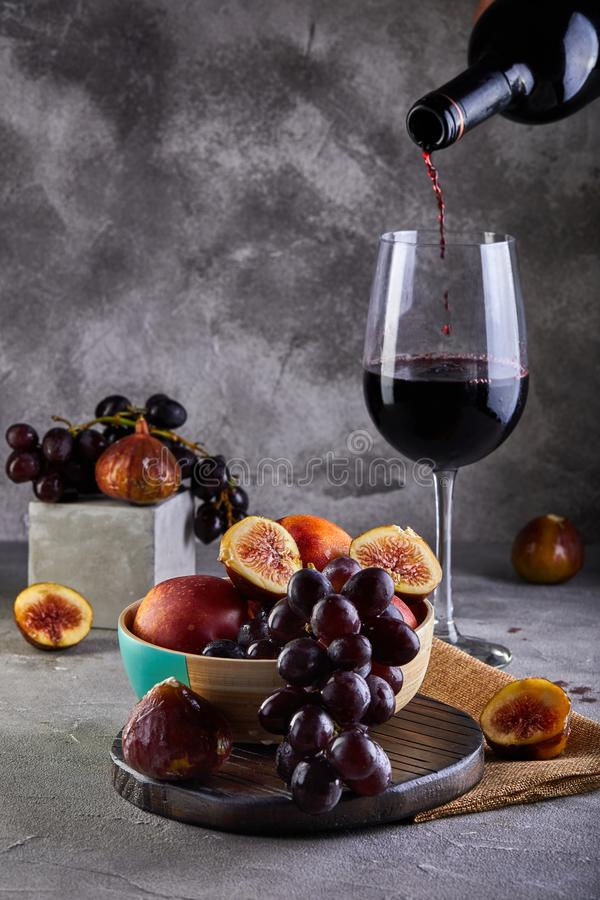 Free Still Life Of Grapes, Peaches, Figs And Glasses Of Red Wine On A Gray Stock Photography - 154341022