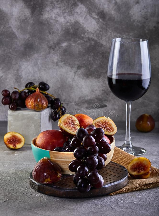 Free Still Life Of Grapes, Peaches, Figs And Glasses Of Red Wine On A Gray Royalty Free Stock Images - 154341059