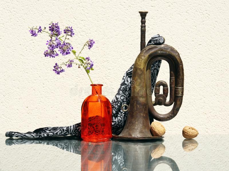 Still life with old rusty bugle stock images
