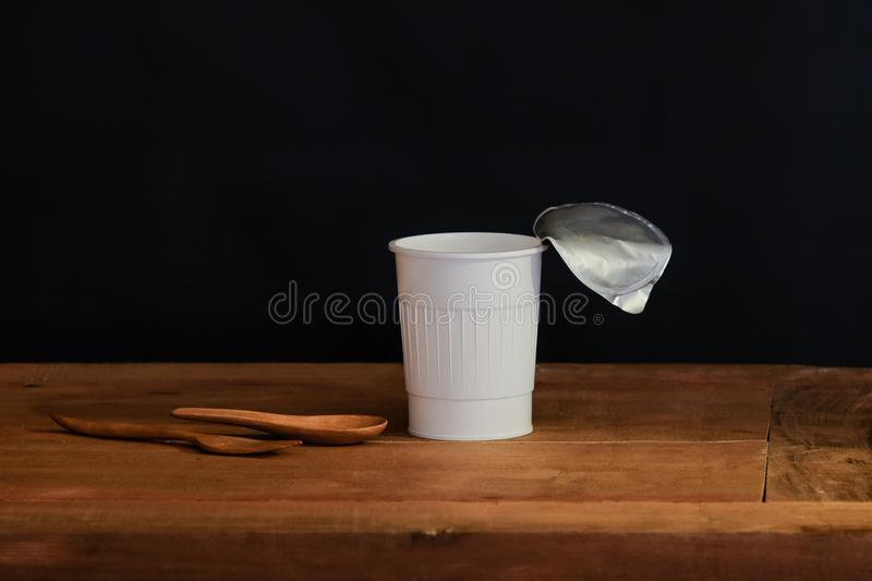 Still life open white cup on black. Background stock photo