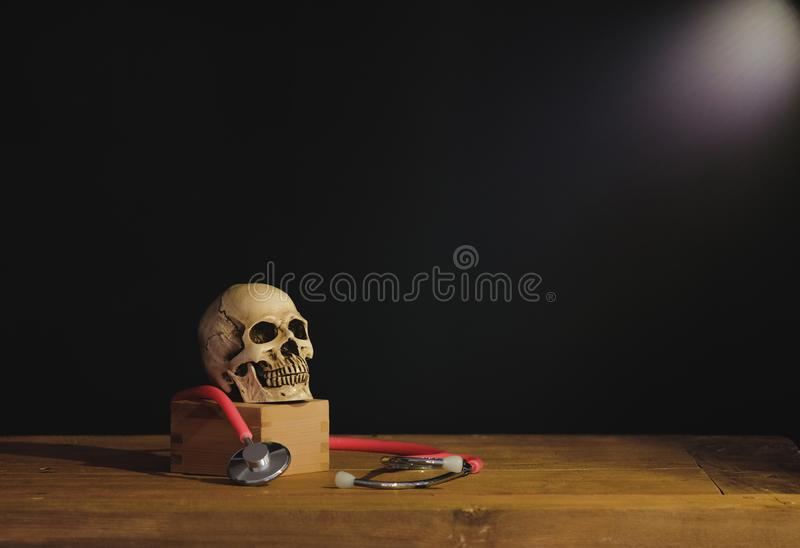Still life painting photography with human skull. On text book royalty free stock image