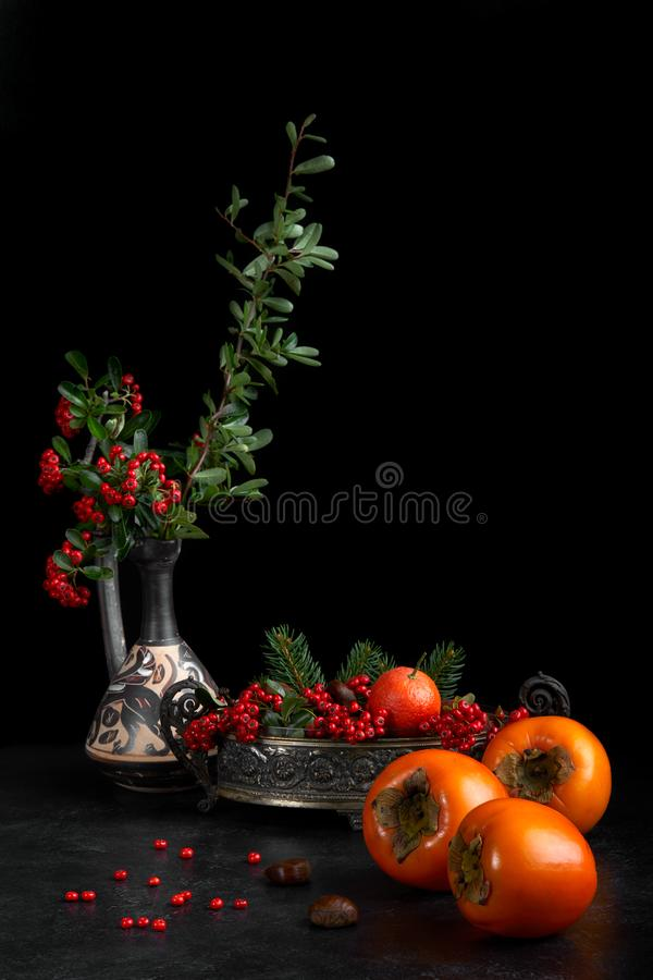 Still Life With Persimmon And Berries stock images