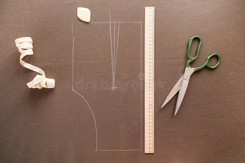 Still life photo of a suit pattern template with tape measure, c. Halk and scissors. Sewing and tailoring tools and accesories stock image