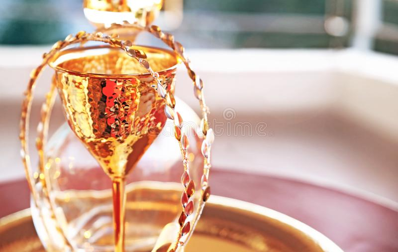 Traditional wedding crowns, decanter and chalice - greek wedding objects. Still life photography of traditional wedding crowns, decanter and chalice - greek stock images