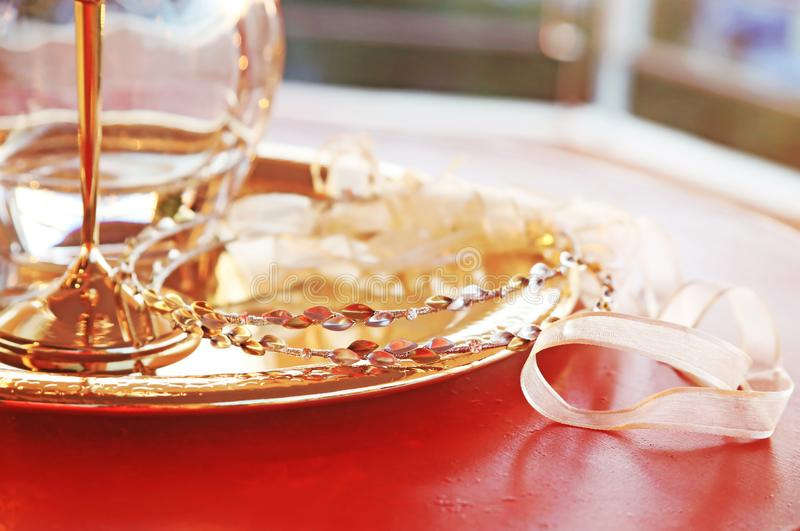 Traditional wedding crowns, decanter and chalice - greek wedding objects. Still life photography of traditional wedding crowns, decanter and chalice - greek stock image