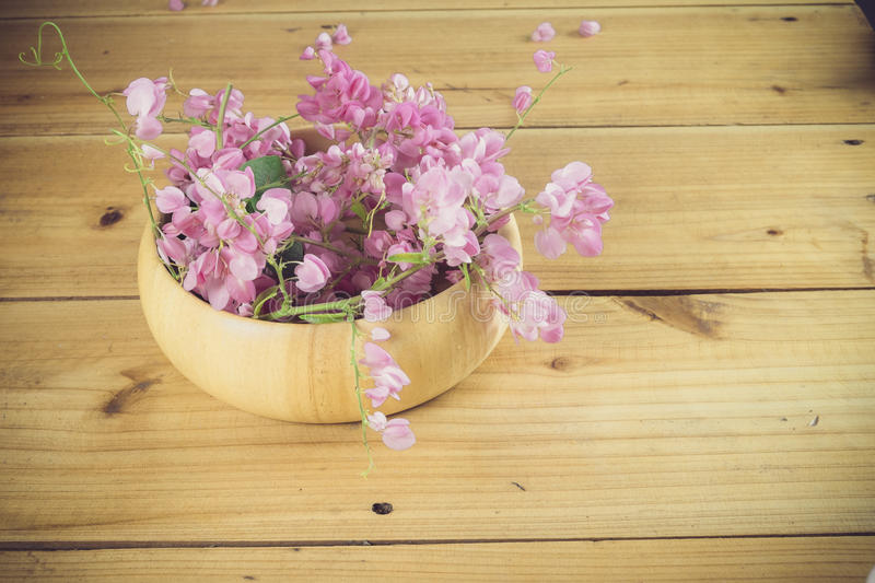 Still life with pink flowers on wooden table over grunge background. Valentine concept royalty free stock photos
