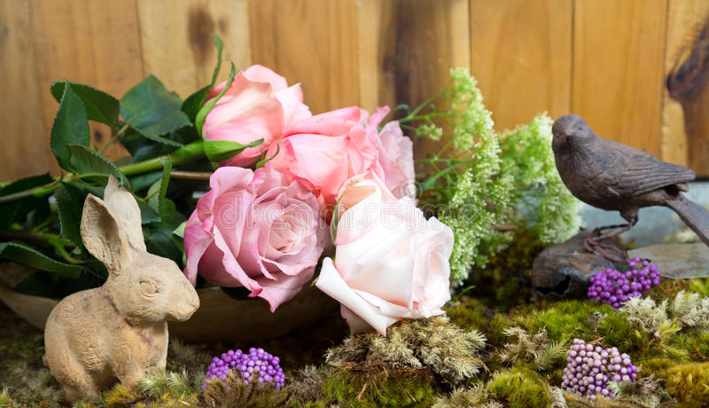 Still life with pink of rose and Rabbit ceramic plaster beside royalty free stock images