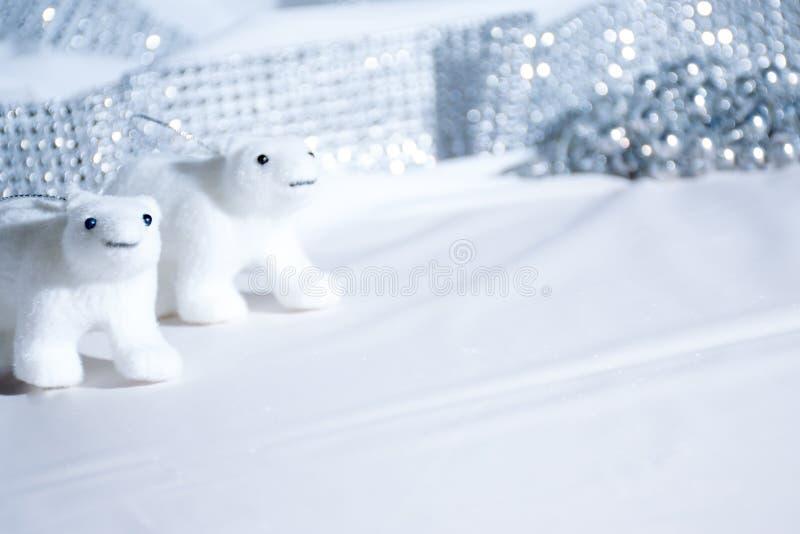 Polar bear decorations in white Christmas scene. Two polar bear models in sparkling, white Christmas still life scene royalty free stock photos
