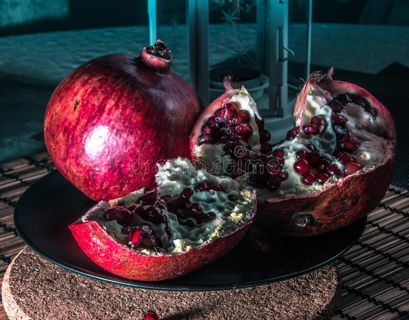 Still life with pomegranate. Juicy taste of the pomegranate. Freshness of summer. Fruits. Fruit freshness. pomegranate juice. abstraction. Still-life stock images