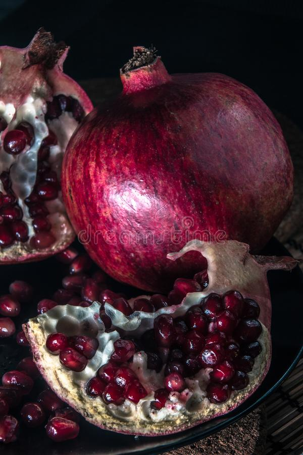 Still life with pomegranate. Juicy taste of the pomegranate. Freshness of summer. Fruits. Fruit freshness. pomegranate juice. abstraction. Still-life royalty free stock images