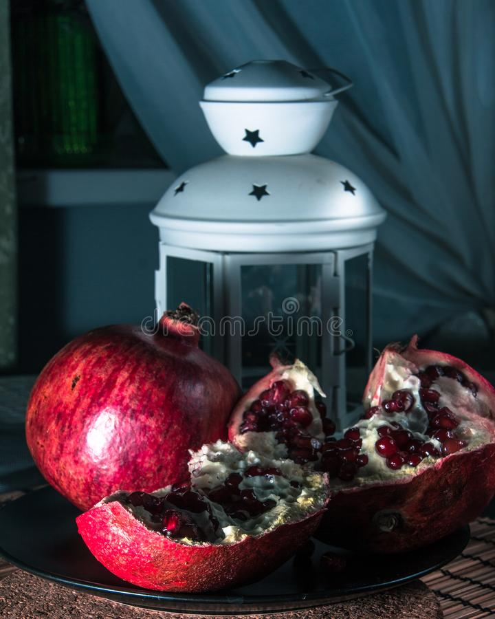 Still life with pomegranate and lantern. royalty free stock image