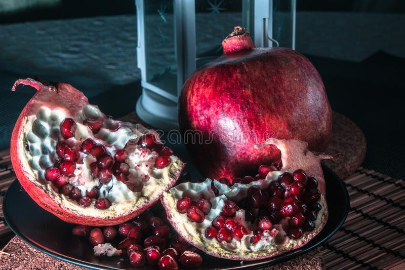 Still life with pomegranate and lantern. stock image